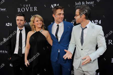 """David Michod, left, writer/director of """"The Rover,"""" poses with cast members, from left, Susan Prior, Robert Pattinson and Guy Pearce at the U.S. premiere of the film on in Los Angeles"""