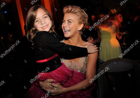"""Julianne Hough, a cast member in """"Safe Haven,"""" lifts up fellow cast member Mimi Kirkland at the post-premiere party for the film, in the Hollywood section of Los Angeles"""