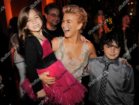 """Julianne Hough, center, a cast member in """"Safe Haven,"""" poses with fellow cast members Mimi Kirkland, left, and Noah Lomax at the post-premiere party for the film on in the Hollywood section of Los Angeles"""
