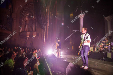Ezra Koenig, Chris Baio, and Chris Tomson with Vampire Weekend performing at The Fox Theater, in Atlanta