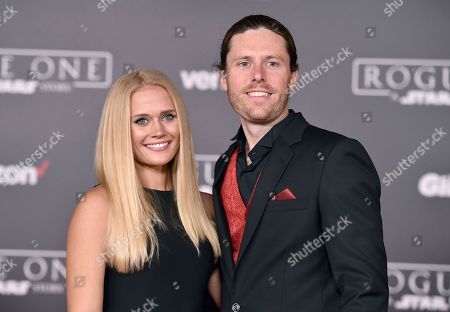 """Carly Schroeder, left, and Jeremy Lazelle arrive at the world premiere of """"Rogue One: A Star Wars Story"""" at the Pantages Theatre, in Los Angeles"""