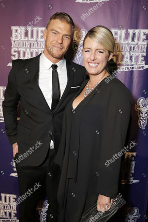 Stock Image of Writer/Producer/Actor Alan Ritchson and Catherine Ritchson seen at World premiere of 'Blue Mountain State: The Rise of Thadland' at The Fonda Theatre, in Los Angeles, CA
