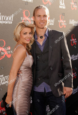 Actor Jilon VanOver (right) and guest arrive at the world premiere of Hatfields & McCoys on in Los Angeles