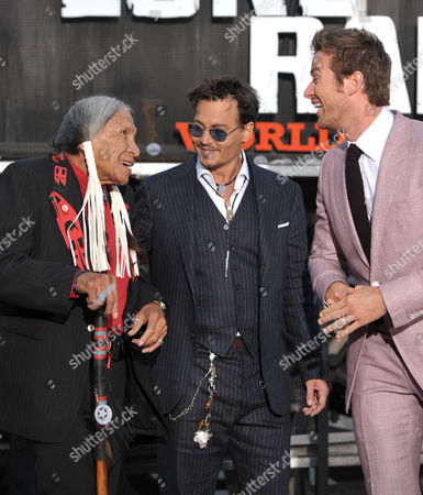 """From left, Saginaw Grant, Johnny Depp, and Armie Hammer appear on stage at the world premiere of """"The Lone Ranger"""" at Disney California Adventure on in Anaheim, Calif"""