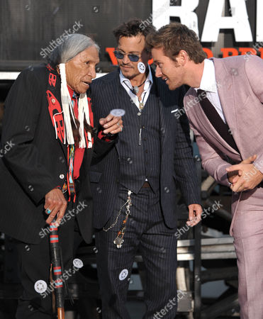 "Stock Image of From left, Saginaw Grant, Johnny Depp, and Armie Hammer appear on stage at the world premiere of ""The Lone Ranger"" at Disney California Adventure on in Anaheim, Calif"