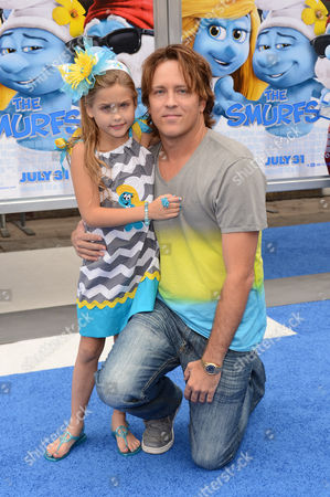 """Dannielynn Marshall, left, and Larry Birkhead arrive at the world premiere of """"The Smurfs 2"""" at the Regency Village Theatre on in Los Angeles"""