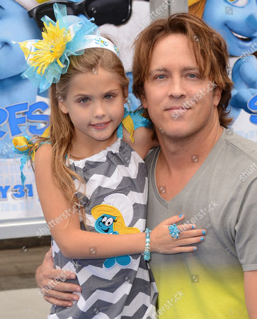 """Larry Birkhead, right, and his daughter Dannielynn Marshall arrive at the world premiere of """"The Smurfs 2"""" at the Regency Village Theatre on in Los Angeles"""