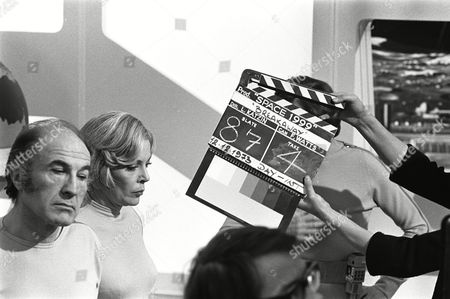 Barry Morse and Barbara Bain, behind the scenes, clapperboard