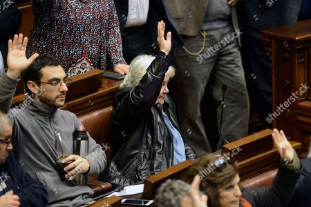 Uruguay's Senator Lucia Topolansky votes in favor of the resignation of Vice President Raul Sendic, in Montevideo, Uruguay, . Sendic resigned Wednesday amid allegations of corruption and was replaced by Topolansky, the first woman in Uruguay to hold that position