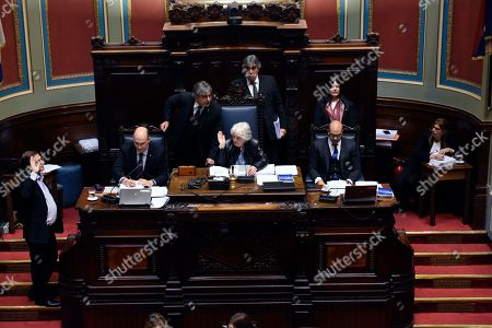 Uruguay's newly named Vice President Lucia Topolansky presides over a session in Senate chambers, in Montevideo, Uruguay, . Vice President Raul Sendic resigned Wednesday amid allegations of corruption and was replaced by Topolansky, the first woman in Uruguay to hold that position