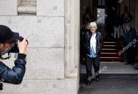 Uruguay's newly named Vice President Lucia Topolansky leaves Parliament followed by her husband, former President Jose Mujica, right, after presiding over a session in her new role, in Montevideo, Uruguay, . Vice President Raul Sendic resigned Wednesday amid allegations of corruption and was replaced by Topolansky, the first woman in Uruguay to hold that position