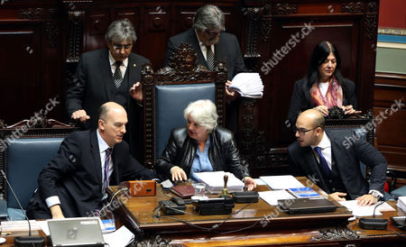 The new Uruguayan Vice-President and President of the Parliament General Assembly Lucia Topolansky (C) speaks with the secretaries of the Senate chamber Hebert Paguas (R) and Jose Pedro Montero (L) during a session on the resignation of Urugayan Vice-President Raul Sendic, in Montevideo, Uruguay, 13 September 2017. The new Uruguayan Vice-President and President of the Parliament General Assembly Lucia Topolansky, wife of former President and current senator Jose Mujica, replaced on 13 September Sendic in post, becoming the first woman Vice-President of Uruguay.