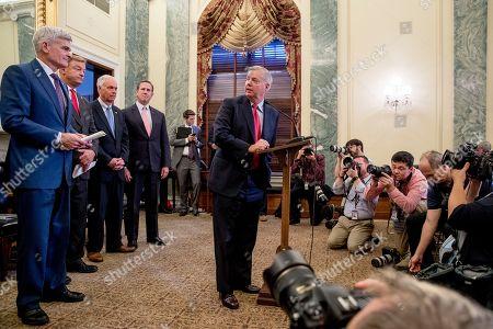 Lindsey Graham, Bill Cassidy, Ron Johnson, Dean Heller, Rick Santorum. From left, Senator Bill Cassidy, R-La., Senator Dean Heller, R-Nev., Senator Ron Johnson, R-Wis., former Senator Rick Santorum, R-Pa., and Senator Lindsey Graham, R-S.C., hold a press conference on Capitol Hill in Washington, to unveil legislation to reform health care