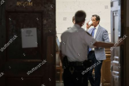 A court officer holds the door for former congressman Anthony Weiner as he prepares to leave the courtroom, in New York. Weiner and his estranged wife, Huma Abedin, have appeared before a New York City judge to ask for privacy in their divorce case. Their lawyers asked for parts of the case to be sealed because it involves visitation for their young child