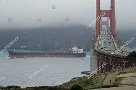 The self discharging bulk carrier Honourable Henry Jackman makes its way past the Golden Gate Bridge, in San Francisco