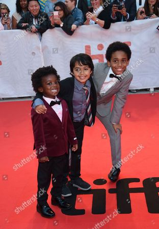 """Stock Image of Aiden Akpan, Callan Farris, Reece Cody. Actors Aiden Akpan, left, Callan Farris and Reece Cody attend the premiere for """"Kings"""" on day seven of the Toronto International Film Festival, at Roy Thomson Hall, in Toronto"""