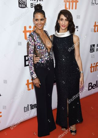 """Halle Berry, Deniz Gamze Erguven. Actress Halle Berry, left, and director Deniz Gamze Erguven attend the premiere for """"Kings"""" on day 7 of the Toronto International Film Festival, at Roy Thomson Hall, in Toronto"""