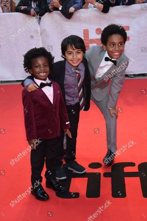 """Stock Photo of Aiden Akpan, Callan Farris, Reece Cody. Actors Aiden Akpan, left, Callan Farris and Reece Cody attend the premiere for """"Kings"""" on day 7 of the Toronto International Film Festival, at Roy Thomson Hall, in Toronto"""