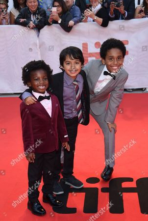 "Stock Picture of Aiden Akpan, Callan Farris, Reece Cody. Actors Aiden Akpan, left, Callan Farris and Reece Cody attend the premiere for ""Kings"" on day 7 of the Toronto International Film Festival, at Roy Thomson Hall, in Toronto"
