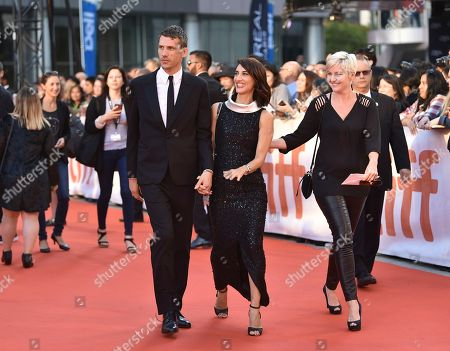 """Director Deniz Gamze Erguven, right, and guest arrive at the premiere for """"Kings"""" on day 7 of the Toronto International Film Festival, at Roy Thomson Hall, in Toronto"""