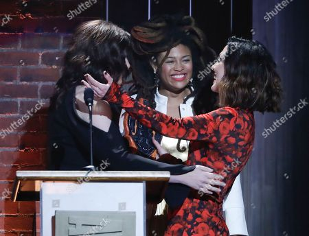 Amanda Shires, Brandy Clark, Valerie June. Amanda Shires, right, is presented with the emerging artist of the year award by Brandy Clark, left, and Valerie June during the Americana Honors and Awards show, in Nashville, Tenn