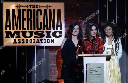 Amanda Shires, Brandy Clark, Valerie June. Amanda Shires, center, is presented with the emerging artist of the year award by Brandy Clark, left, and Valerie June, right, during the Americana Honors and Awards show, in Nashville, Tenn