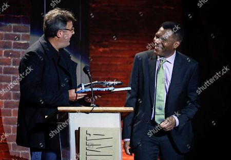 Robert Cray, Vince Gill. Robert Cray, right, is presented the lifetime achievement award for performance by Vince Gill, left, during the Americana Honors and Awards show, in Nashville, Tenn