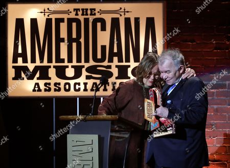 Stock Image of John Prine, Iris Dement. Iris Dement hugs John Prine after Prine presented her with the lifetime achievement trailblazer award during the Americana Honors and Awards show, in Nashville, Tenn