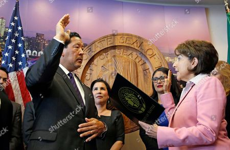 Stock Image of Seattle City Council President Bruce Harrell, left, is sworn in as Seattle mayor by City Clerk Monica Martinez Simmons, in Seattle. Harrell assumed the temporary position following the resignation of Mayor Ed Murray, who resigned after it was reported that a fifth man had accused Murray of molesting him decades ago. Murray has vehemently denied all of the accusations against him and had already decided not to seek re-election