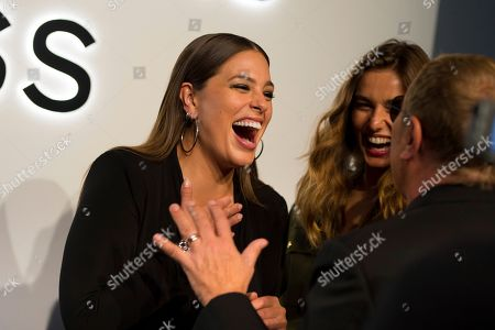 Ashley Graham, Andreea Diaconu, Michael Kors. Ashley Graham, left, Andreea Diaconu, middle, and Michael Kors attend the Michael Kors ACCESS Smartwatch launch event at ArtBeam, in New York