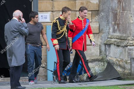 William Moseley (black jacket) who plays Prince Liam and Max Brown (red jacket) who plays Prince Robert in the tv series The Royals spotted filming at Ely Cathedral in Cambridgeshire