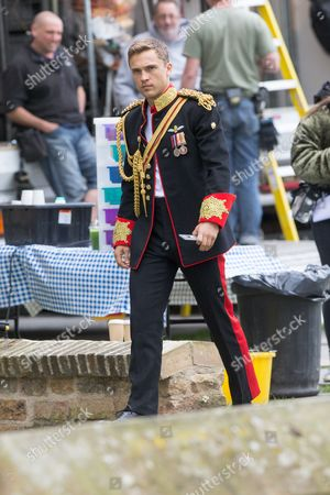 William Moseley who plays Prince Liam in the tv series The Royals filming at Ely Cathedral in Cambridgeshire