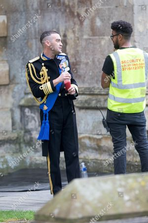 Jake Maskall who plays Cyrus in the tv series The Royals filming at Ely Cathedral in Cambridgeshire