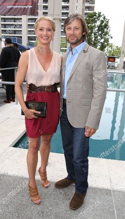 """From left, actors Katherine LaNasa and Grant Show during the arrivals for the opening night performance of """"A Parallelogram"""" at the Center Theatre Group/Mark Taper Forum, in Los Angeles, Calif"""