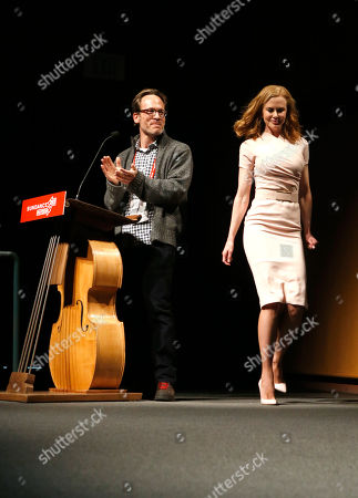 """Producer Michael Costigan, left, and actress Nicole Kidman speak onstage at Fox Searchlight's """"The Stoker"""" premiere during Sundance Film Festival on in Park City, Utah"""