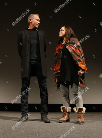 """Producer Michael Costigan, left, and composer Emily Wells speak onstage at Fox Searchlight's """"The Stoker"""" premiere during Sundance Film Festival on in Park City, Utah"""