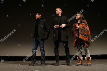 """From left, Cinematographer Chung-hoon Chung, producer Michael Costigan and composer Emily Wells speak onstage at attends Fox Searchlight's """"The Stoker"""" premiere during Sundance Film Festival on in Park City, Utah"""