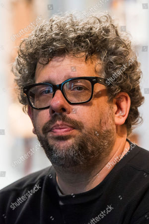 """Neil LaBute poses on the set of his new play """"The Way We Get By"""" at the Second Stage Theatre, in New York"""