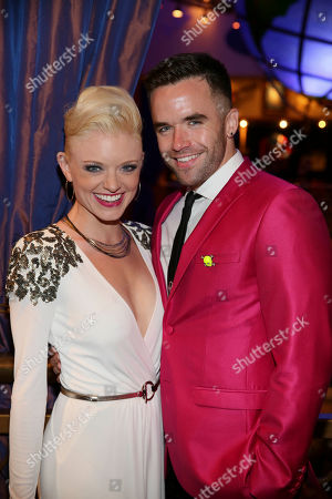 """From left, cast members Ruby Lewis and Brian Justin Crum pose during the party for the opening night performance of Queen and Ben Elton's """"We Will Rock You"""" at the Center Theatre Group/Ahmanson Theatre, in Los Angeles, Calif"""