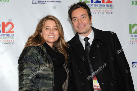 """Nancy Juvonen, left, and late night TV host Jimmy Fallon appear backstage at """"12-12-12"""" The Concert for Sandy Relief, on in New York"""