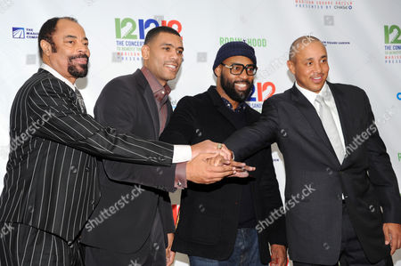 From left, Earl Monroe, Allan Houston, Baron Davis and John Starks of the New York Knicks appear backstage at 12-12-12 The Concert for Sandy Relief, on in New York