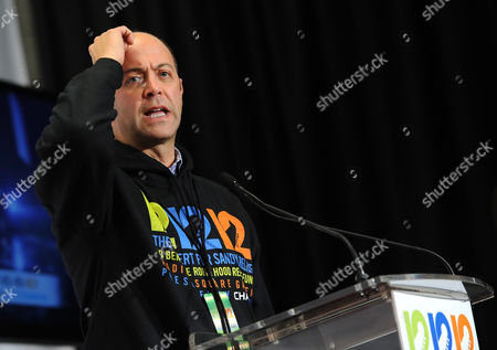 """Stock Picture of Robin Hood Foundation executive director David Saltzman speaks to the press backstage at """"12-12-12"""" The Concert for Sandy Relief at Madison Square Garden on in New York"""