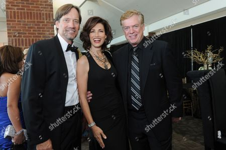"""Kevin Sorbo and wife Sam Jenkins pose with Chris McDonald at the 12th Annual Starky Foundation """"So The World May Hear"""" Gala on in St. Paul, Minnesota"""