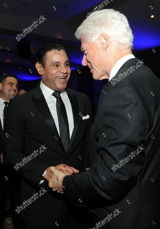 "Sammy Sosa and former President Bill Clinton are seen at the 12th Annual Starky Foundation ""So The World May Hear"" Gala on in St. Paul, Minnesota"