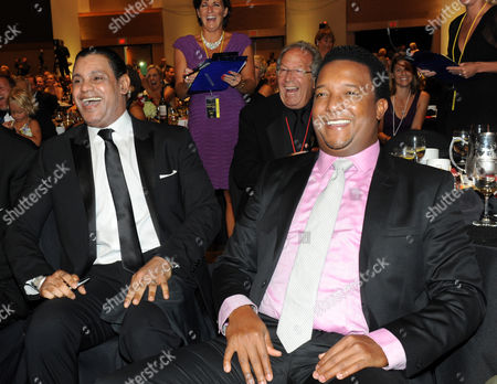 "Baseball legends Sammy Sosa, left, and Pedro Martinez are seen at the 12th Annual Starkey Hearing Foundation ""So The World May Hear"" Gala on in St. Paul, Minnesota"