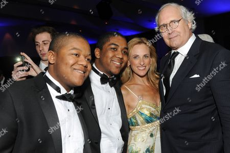 """Stock Image of Kyle Massey (left), Chris Massey, Marlee Matlin and Chevy Chase are seen at the 12th Annual Starkey Hearing Foundation """"So The World May Hear"""" Gala on in St. Paul, Minnesota"""