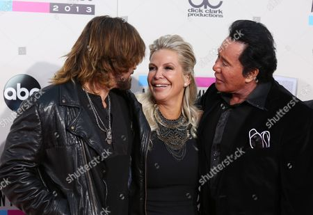 Billy Ray Cyrus, Kathleen McCrone and Wayne Newton arrive at the 2013 American Music Awards, on in Los Angeles