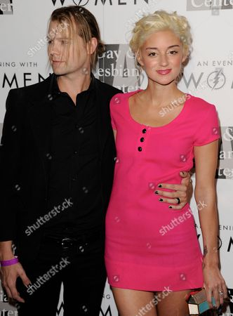 """Bobby Alt, left, and Caroline D'Amore arrive at the 2013 """"An Evening With Women"""" event at the Beverly Hilton Hotel on in Los Angeles"""