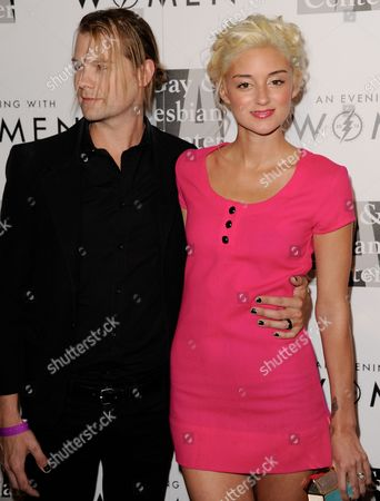 "Bobby Alt, left, and Caroline D'Amore arrive at the 2013 ""An Evening With Women"" event at the Beverly Hilton Hotel on in Los Angeles"