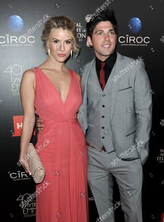 Linsey Godfrey, left, and Robert Adamson arrive at the 40th Annual Daytime Emmy Awards, in Beverly Hills, Calif